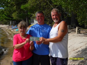Carl Davis Presents Gift Certificate to the Quigley's